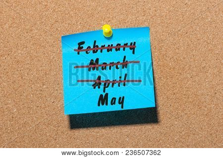 May Month Beginning. Text Written On Blue Sticker Pinned At Noticeboard With Crossed Out March And A