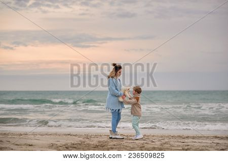Mom And Son On The Beach.