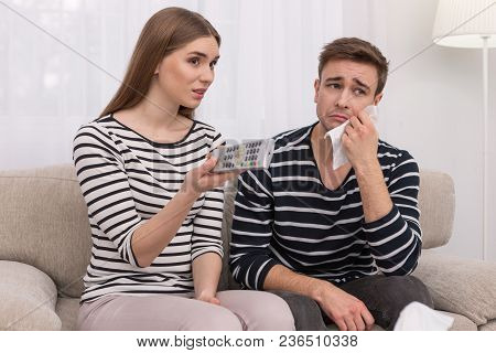 Expressing Emotions. Amazed Young Woman Watching A Film With Her Boyfriend And He Crying