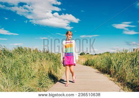 Kid Girl Tourist Enjoying Promenade In Camargue, Marais Du Vigueirat, Swamps, Pathway In Natural Res
