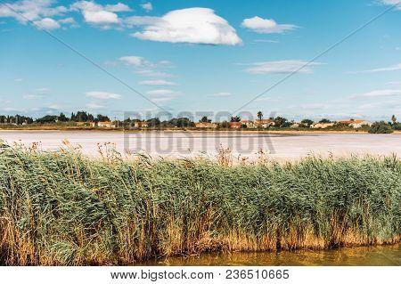 Aigues-Mortes, Salins du Midi, colorful landscape with salt marshes poster