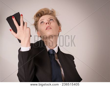 Shocked, Disappointed Or Exhausted Business Woman Holding Smart Phone And Looking Up