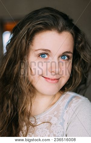 Close Up Portrait Of Beautiful Smiling Young Caucasian Woman Girl. Pretty Young Caucasian Woman At H