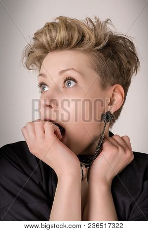 Surprised Blond Woman With Mouth Open And Covered By Her Hand