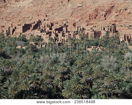 Old Town Of Tinghir, Green Palm Oasis And Rocky Atlas Mountains Range Landscapes In Southeastern Mor