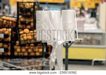 Rack Stand With Free Plastic Bags - Cellophane Package In The Supermarket Store. Environmental Pollu
