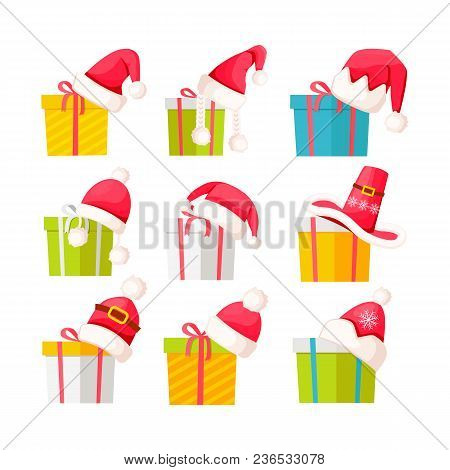Set Of Gift Boxes With Santa Claus Hats On Tops Isolated On White. Vector Poster Of Presents In Colo