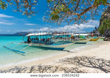 View of traditional boats at Coron Island beach, Philippines. Coron Island is a wedge-shaped limestone island in the province of Palawan.