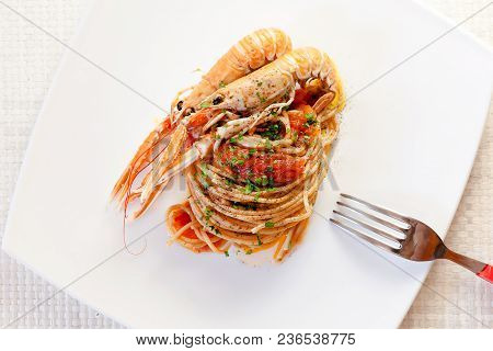 Ready Dish Of Pasta With Tomato Sauce And Nephrops, Parsley And Pepper. Fish Cuisine, Shellfish. Ita