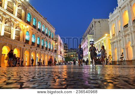 Macau, China- 07 Apr, 2018: Tourists Visit The Historic Center Of Macau - Senado Square. Historic Ce