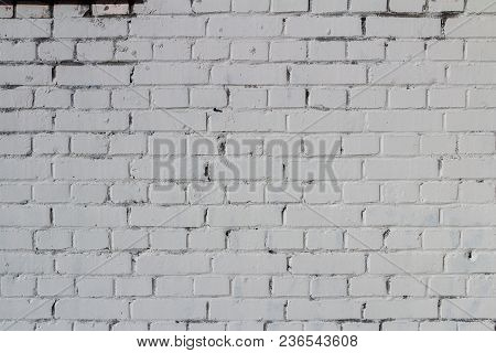 White Paint On Brick Wall With Black Crack
