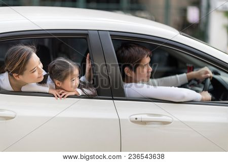 Happy Man And Woman With Little Child Driving In Car.family Safety Transport Road Trip And Happy Peo