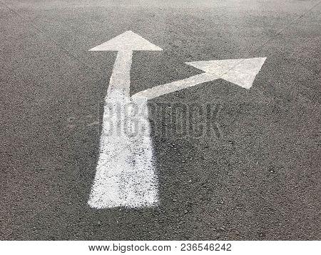 Straight And Slight Right White Arrow Sign On Asphalt Road, Under Sun Light