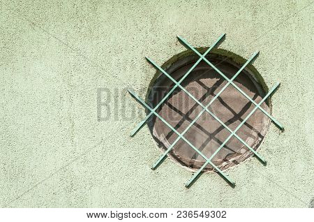 Metal Safety Grid Or Gratings On The Window From The Street Side To Protect House From Burglary