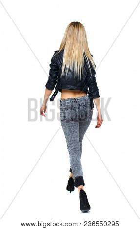 back view of walking woman. beautiful girl in motion. backside view of person.  Rear view people collection. Isolated over white. The blonde on his heels goes into the distance