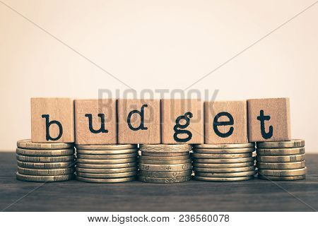 The Word Budget, Text On Wooden Cubes On Currency Money, Top Of Gold Coins Stack, Vintage Retro Styl