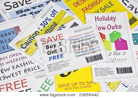 Completely fake fashion coupons with scissor.  Fictional bar codes.  All coupons were created by the photographer.  No real ads were used.  Photographs in the coupons are the photographers work.