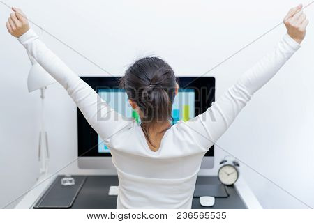 Young Asian Beautiful Woman Sitting In Front Of Computer And Stretch Oneself  After Long Working. St