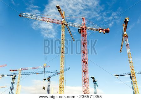 Lot Of High Tower Cranes Work On The Construction Of A New Buildings