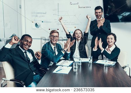 Multi Ethnic Group Of Successful Business People Rejoice At Success In Conference Hall. Business Mee