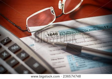 Tax Form With Pen Calculator And Glasses ** Note: Shallow Depth Of Field