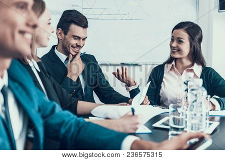 Friendly Company Of Business People Work In Conference Room. Business Meeting. Encounter In Boardroo