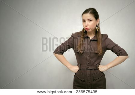 Dissatisfied Annoyed Girl Isolated On Gray Background With Copy Space. Displeased Boss Woman. Wrathf