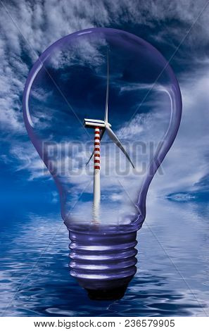 Silhouette Of A Light Bulb On Top .in The Background A Wind Generator In A Landscape With The Sky An