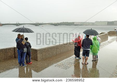 Saint-petersburg.russia.august.5.2017.granite Pier On The River.the Clouds In The Sky And Heavy Rain