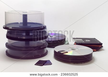 Data Storages Big Set : Stacks Of Floppy Diskette, Cds, Dvds And A Few Flash Storages