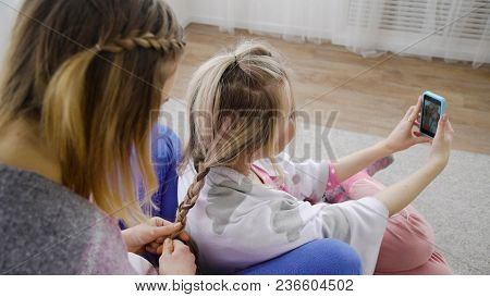 Friends Bff Leisure Communication. Hair Braiding And Selfie. Girls Beauty Party