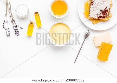 Homemade Cosmetics With Honey. Handmade Soap, Spa Salt, Cream On White Background Top View.