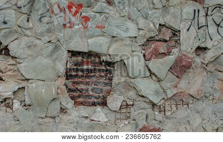 Texture Of Damaged Stone Wall. Background Of The Damaged Stone Wall