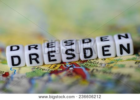 Word Dresden Formed By Alphabet Blocks On Atlas Map Geography