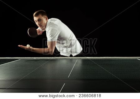 Selective Focus Of Tennis Player With Tennis Racket And Ball In Hands Standing At Tennis Table Isola