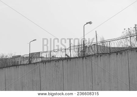 Fence With Barbed Wire, Place Of Detention, Prison. Black And White Photo