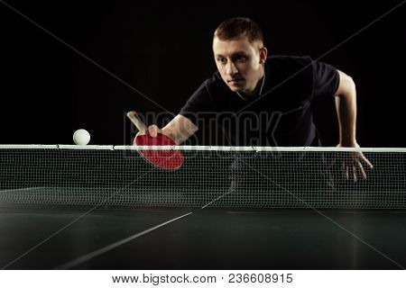 Selective Focus Of Focused Tennis Player In Uniform Playing Table Tennis Isolated On Black