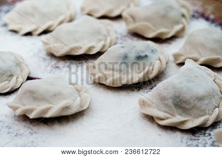 Vareniki Dumplings With Potatoes On White Background - Traditional Ukrainian And Russian Food. Cooki