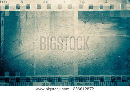 Film negative frames on rough background