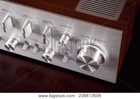 Vintage Stereo Amplifier Metal Frontal Panel Volume Control Knob Angled View Closeup