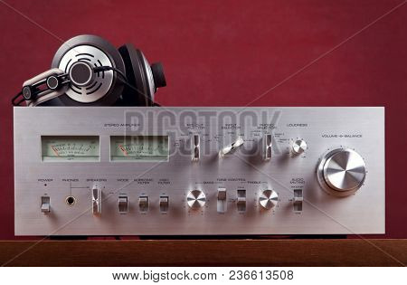 Vintage Stereo Amplifier Frontal Panel with VU meters Dark Background Closeup