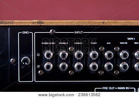 Vintage Stereo Amplifier Black Rear Panel Terminals in Row Closeup