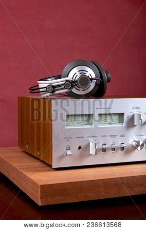 Vintage Stereo Amplifier Front Panel and Cabinet with Headphones Angled View