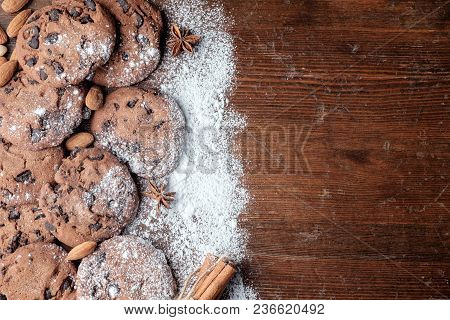 Chocolate Chips Cookies On Table With Dark Rustic Texture And With Copy Space For Your Text. Top Vie