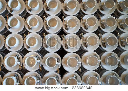 Set Of Empty White Ceramic Tea Or Coffee Cup And Saucers, Top View. Group Of Empty Cups Stacked In R