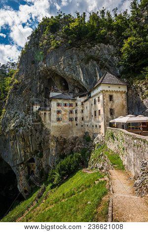 Renaissance Castle Built Inside Rocky Mountain In Predjama, Slovenia. Famous Tourist Place In Europe