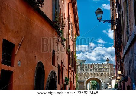 Rome, Italy - May 17, 2017: Generic Residential Architecture And Arch In Trastevere, Rome, Italy.