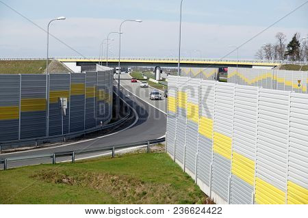 The Road Is Protected Against Noise Emission By Noise-absorbing Barrier (also Called A Soundwall, No