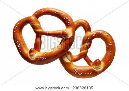 German Soft Pretzel. Two German bread pretzels on a white background.