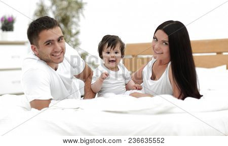A young family with young children to bed in the bedroom